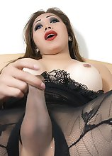 Exotic Blue Eyed Brunette stroking in a Lace BodyStocking